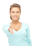Woman with an open hand ready for handshake. Lovely woman with an open hand ready for handshake stock photography