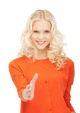 Woman with an open hand ready for handshake Royalty Free Stock Photography