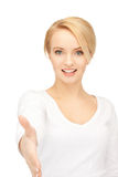 Woman with an open hand ready for handshake Royalty Free Stock Images