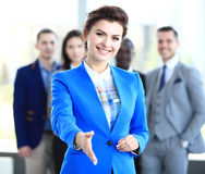 Woman with an open hand ready to seal a deal. Portrait of a women with an open hand ready to seal a deal Stock Images