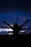Woman with open hands to clouds sky stock photos