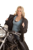 Woman open leather jacket sit on motorcycle Stock Images