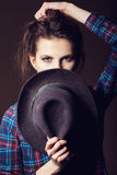 Woman with open lips in black hat on dark background royalty free stock photography