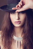 Woman with open lips in black hat on dark background stock photos