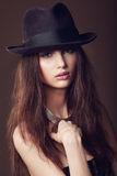 Woman with open lips in black hat on dark background royalty free stock photos