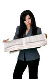 Woman with open newspaper reading. Stock Photography