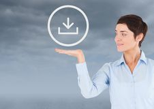Woman with open palm hand under download icon Stock Photography