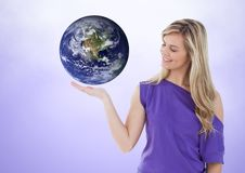 Woman with open palm hand under world earth. Digital composite of Woman with open palm hand under world earth Royalty Free Stock Image