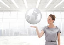 Woman with open palm hand under world earth globe. Digital composite of Woman with open palm hand under world earth globe Royalty Free Stock Photo