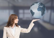Woman with open palm hand under world earth globe. Digital composite of Woman with open palm hand under world earth globe Royalty Free Stock Photography
