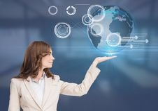 Woman with open palm hand under world earth globe interface Royalty Free Stock Image