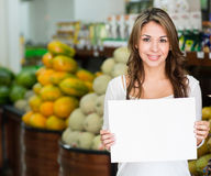 Woman with an open sign at her business Stock Image