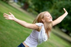 Woman with opened arms Stock Photo