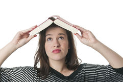 Woman with opened book on head. Young woman with book on her head Stock Image