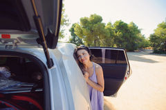 Woman and Opened Car Royalty Free Stock Photo