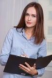 Woman opened the folder writes it Royalty Free Stock Photo