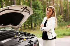 Woman opened the hood broken car Stock Image