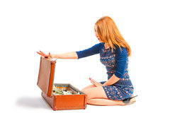 Woman opened suitcase full of money Royalty Free Stock Photo
