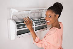 Woman Opening Air Conditioner Stock Photos