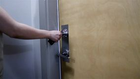 Woman opening apartment door. Close up woman opening apartment door stock footage