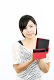 Woman opening a box Royalty Free Stock Images