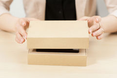 Woman opening box with new parcel, close-up Royalty Free Stock Image