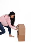 Woman opening a box Stock Photography