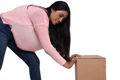 Woman opening a box Stock Images