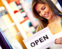 Woman opening a business Royalty Free Stock Image