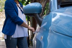 A woman opening car door royalty free stock photos