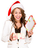 Woman opening a Christmas gift Stock Photography