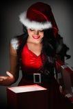 Woman opening christmas gift Stock Photo