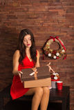 Woman opening Christmas present Royalty Free Stock Photography