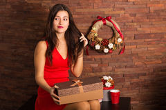 Woman opening Christmas present Stock Photography
