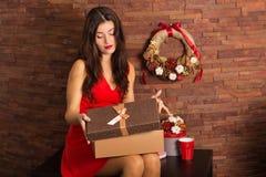 Woman opening Christmas present Stock Image