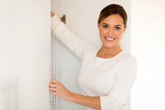 Woman opening a closet Royalty Free Stock Image