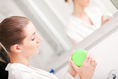 Woman opening cream container Stock Images