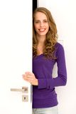 Woman opening door Royalty Free Stock Photography