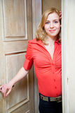 Woman opening a door stock photography