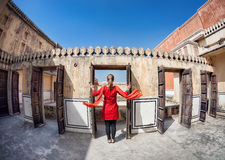 Woman opening door in Rajasthan Royalty Free Stock Photos