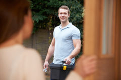 Woman Opening Door To Repairman Stock Photography