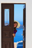 Woman opening door to the sea Stock Photos