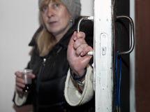 Woman Opening Door Stock Image