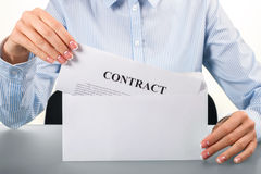 Woman opening envelope with contract. Stock Photo