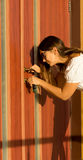 Woman opening a front door with a key Royalty Free Stock Images