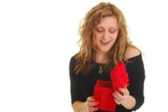 Woman opening gift Royalty Free Stock Image