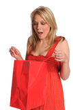 Woman Opening Gift Bag Stock Images
