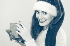 Woman opening gift box. Christmas time Royalty Free Stock Photos