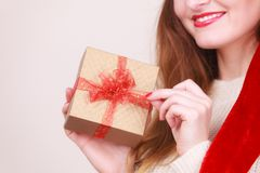 Woman opening gift box. Christmas time Royalty Free Stock Photo