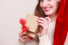 Woman opening gift box. Christmas time Stock Photos